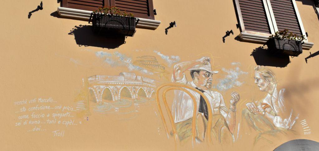murales fellini e mastroianni borgo san giuliano